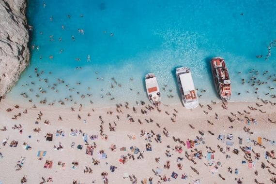 Travel blogger Laura McWhinnie from This Island Life stranded on Shipwreck Beach, Zakynthos - Greece.