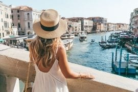 Laura McWhinnie from This Island Life on Rialto Bridge, looking out over Venice while in Italy.